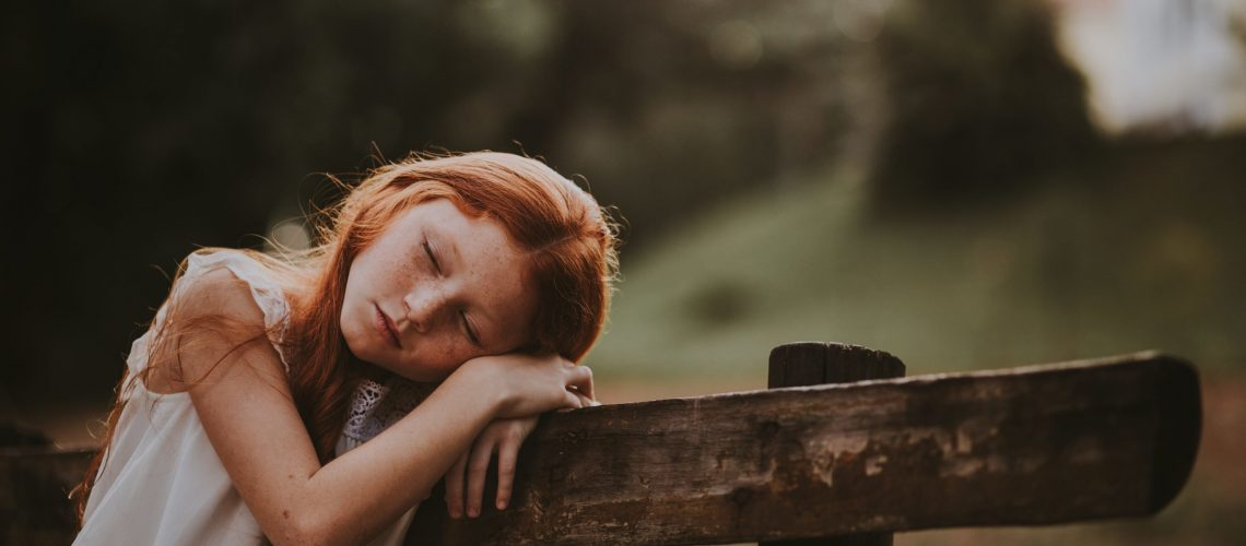 Canva - Girl Leaning Her Head on Her Hand While Closing Her Eyes